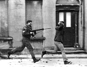 A youth is arrested at gunpoint by a Paratrooper in Derry on Bloody Sunday Picture by Fred Hoare