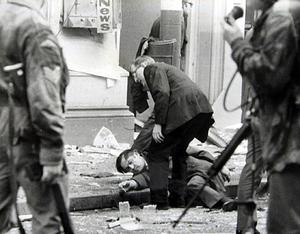 A man lies injured on the ground after being caught in a bomb explosion in Donegall Street, Belfast. Picture by Fred Hoare