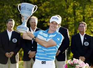 Rory McIlroy holds the trophy after winning the Deutsche Bank Championship PGA golf tournament at TPC Boston in Norton, Mass., Monday, Sept. 3, 2012. (AP Photo/Michael Dwyer)