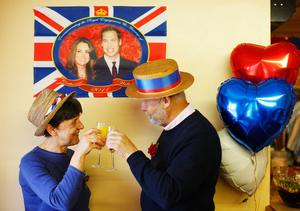 YARDLEY HASTINGS,  UNITED KINGDOM - APRIL 29 : Debbie Smith and Brian Robson enjoy a champagne breakfast in the village hall as they prepare to celebrate the marriage of Prince William to Catherine Middleton on April 29, 2011 in  Northamptonshire, United Kingdom.  The marriage of Prince William, the second in line to the British throne, to Catherine Middleton is being held in London today. The Archbishop of Canterbury conducted the service which was attended by 1900 guests, including foreign Royal family members and heads of state. Thousands of well-wishers from around the world have also flocked to London to witness the spectacle and pageantry of the Royal Wedding and street parties are being held throughout the UK.  (Photo by Mark Thompson/Getty Images)