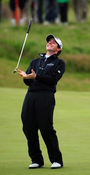 Northern Ireland's Rory McIlroy throws his putter in the air after playing a shot on the green during a practice day for the 2011 Open Championship at Royal St George's, Sandwich. PRESS ASSOCIATION Photo. Picture date: Wednesday July 13, 2011. The 2011 Open Championship begins on Thursday 14th July. See PA Story GOLF Open. Photo credit should read: Owen Humphreys/PA Wire. RESTRICTIONS: Use subject to restrictions. Editorial use only. No commercial use. Call +44 (0)1158 447447 for further information