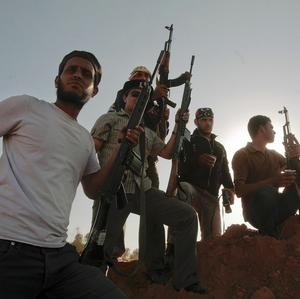Libyan rebel fighters at the southern front line of the city of Misrata (AP)