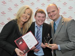 Thomas Mullan accepts his award from Titanic Quarter's Anne Harty and Ralph McLean from the BBC.