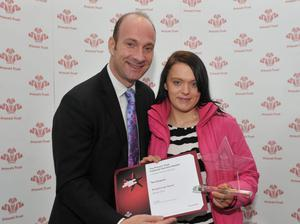 Toni Surgenor from Ballymena accepts her Prince's Trust Breakthrough Award from the BBC's Stephen Watson.