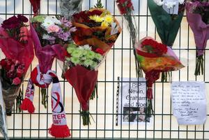 Tributes for Nevin Spence and his family left at Ravenhill