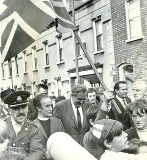 Loyalists waving a Union Jack surround  Home Secretary James Callaghan on the Shankill Road, Belfast.   28/8/1969.