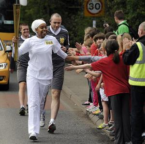 The torch makes its way through Langham in Leicestershire