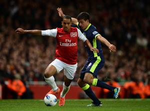 LONDON, ENGLAND - APRIL 16:  Theo Walcott of Arsenal and Franco Di Santo of Wigan battle for the ball during the Barclays Premier League match between Arsenal and Wigan Athletic at Emirates Stadium on April 16, 2012 in London, England.  (Photo by Laurence Griffiths/Getty Images)