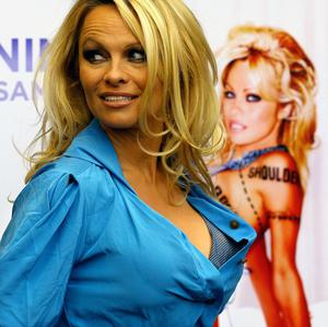 Pamela Anderson unveils her new poster backing People for the Ethical Treatment of Animals