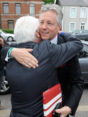 First Minister and DUP leader Peter Robinson arrives at the count in Newtownards Leisure Centre in the Northern Ireland Assembly elections.