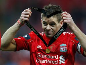 LONDON, ENGLAND - FEBRUARY 26:  Steven Gerrard of Liverpool holds his winners medal after the Carling Cup Final match between Liverpool and Cardiff City at Wembley Stadium on February 26, 2012 in London, England. Liverpool won 3-2 on penalties.  (Photo by Paul Gilham/Getty Images)