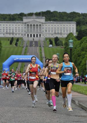 Press Eye Belfast - Northern Ireland - 15th May 2011 - Picture ©Angus Bicker/Presseye.Belfast Telegraph Runher 2011 event at Stormont, Belfast.Cathy McCourt leads the 10k field away from Parliament Buildings.