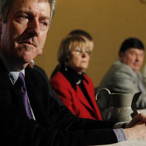 Survivor Steve Travers (left) joins family members and other survivors of the Miami Showband attack at a press conference
