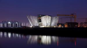 The new Titanic House Vistor centre lights up the skyline in the Titanic quarter, Belfast, Northern Ireland, Sunday, March, 25, 2012.  The £100 million (119.5 million euros; $158 million dollars) building is now finished and will open to the public on March 31. The world's biggest Titanic visitor attraction is to open in its Belfast birthplace later this month and it is  100 years to the day since the doomed ocean liner was completed in the same shipyard, Harland and Wolff.  Northern Ireland hopes the eye-catching building will boost the tourism economy.  (AP Photo/Peter Morrison)