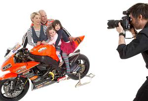 Ryan Farquhar took time out from his North West preparation for this family photo-shoot with wife Karen and children Keeley and Mya, by leading portrait photographer Francis Meaney whose Venture studio will be exhibiting at the race paddock during Race Week Festival