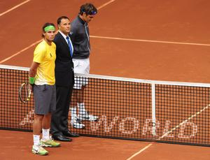 MADRID, SPAIN - MAY 07:  Rafael Nadal of Spain (L), referee Mohamed Lahyani (C) of Sweden and Roger Federer of Switzerland observe a minute of silence in memory of Spanish golf legend Seve Ballesteros prior to the start of their semi final match during day seven of the Mutua Madrilena Madrid Open Tennis on May 7, 2011 in Madrid, Spain.  (Photo by Jasper Juinen/Getty Images)