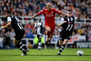 NEWCASTLE UPON TYNE, ENGLAND - APRIL 01:  Jonjo Shelvey of Liverpool competes with Danny Guthrie of Newcastle United during the Barclays Premier League match between Newcastle United and Liverpool at Sports Direct Arena on April 1, 2012 in Newcastle upon Tyne, England. (Photo by Alex Livesey/Getty Images)