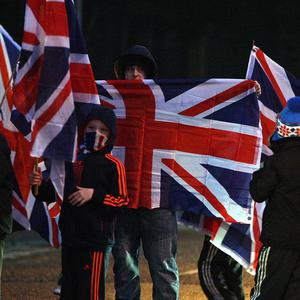Loyalists in Belfast have been protesting against a decision to reduce the number of days the Union flag will fly from City Hall