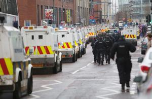 Loyalist protestors and PSNI officers pictured at Belfast City Hall on 22 December 2012
