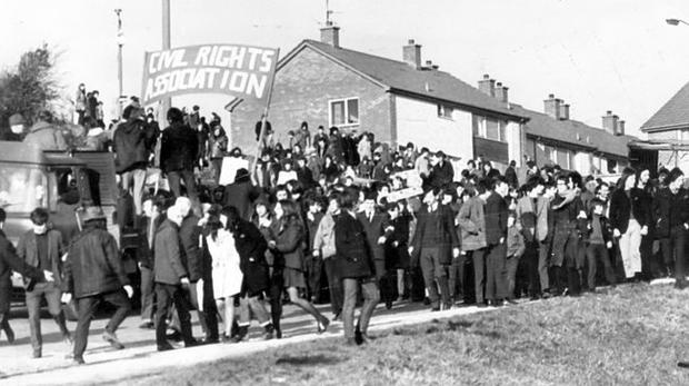 The start of a grim day in Derry. Civil Rights marchers make their way through Creggan.  They defied a Government ban and headed for Guildhall Square, but were stopped by the Army in William Street.  31/1/1972