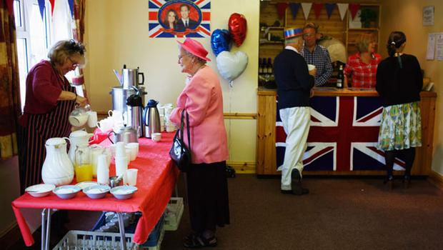 YARDLEY HASTINGS,  UNITED KINGDOM - APRIL 29 : Residents of Yardley Hasting Northamptonshire enjoy a champagne breakfast in the village hall as they prepare to celebrate the marriage of Prince William to Catherine Middleton on April 29, 2011 in  Northamptonshire, United Kingdom.  The marriage of Prince William, the second in line to the British throne, to Catherine Middleton is being held in London today. The Archbishop of Canterbury conducted the service which was attended by 1900 guests, including foreign Royal family members and heads of state. Thousands of well-wishers from around the world have also flocked to London to witness the spectacle and pageantry of the Royal Wedding and street parties are being held throughout the UK.  (Photo by Mark Thompson/Getty Images)