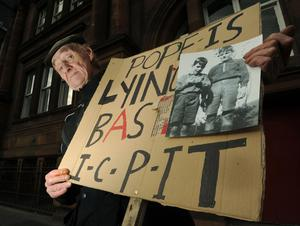 Joseph O'Driscoll originally from Dublin protests with a placard along Lothian Road, Edinburgh ahead of the visit of Pope Benedict XVI who arrived in the city earlier in the day for a four day visit to the United Kingdom