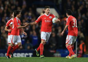 LONDON, ENGLAND - APRIL 04:  Javi Garcia (C) of Benfica celebrates his goal with team mates during the UEFA Champions League Quarter Final second leg match between Chelsea and Benfica at Stamford Bridge on April 4, 2012 in London, England.  (Photo by Clive Rose/Getty Images)