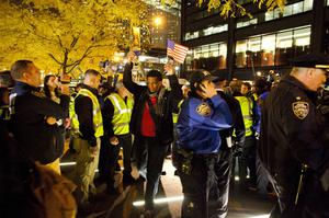 NEW YORK, NY - NOVEMBER 15: Protesters re-enter Zuccotti Park on November 15, 2011 in New York City. Police had removed the protesters from the park early in the morning. A judge ruled that protesters are allowed back to the park but won't be allowed to camp there. Hundreds of protesters, who rallied against inequality in America, have slept in tents and under tarps since September 17 in Zuccotti Park, which has since become the epicenter of the global Occupy movement. The raid in New York City follows recent similar moves in Oakland, California, and Portland, Oregon.  (Photo by Michael Nagle/Getty Images)
