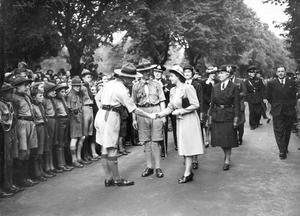 The Queen, Elizabeth 11. Princess Elizabeth 1945 Visit.The Royal visit, Lisburn Princess Elizabeth with Scouts at Wallace Park, shaking hands with scoutmaster H. Scott..  18/7/1945