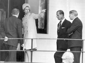 The Queen, Elizabeth 11. 1966 visit.The Queen points out a feature of the new Queen's University playing fields, before she enters Malone Clun house, with the Duke of Edinburth.  5/7/1966