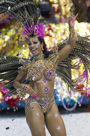 A dancer performs during the parade of Aguia de Ouro samba school in Sao Paulo, Brazil, Sunday, March 6, 2011. Brazil's official carnival is held this year March 4-8. (AP Photo/Andre Penner)