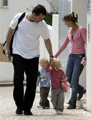 Gerry and Kate McCann, the parents of missing girl Madeleine McCann, walk with their twins Sean, left, and Amelie outside of their apartment in Praia da Luz, southern Portugal, Tuesday, May 22 2007. The British 4-year-old Madeleine disappeared May 3 from the resort apartment where she was on vacation with her family and the police believe she was abducted.
