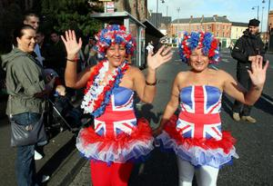 Women dressed in the Union flag colours near Orange Hall in Clifton Street, Belfast, ahead of the start of a massive loyal order parade to mark the centenary of the signing of the pro-Union Ulster Covenant