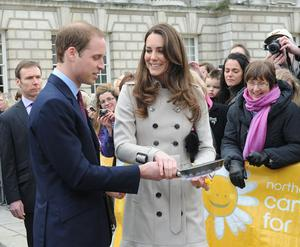 Prince William and Kate Middleton join hands to try flipping a pancake in the grounds of City Hall Belfast today. PRESS ASSOCIATION Photo. Picture date: Tuesday March 8, 2011. See PA story ULSTER Royal. Photo credit should read: Simon Graham/Harrison Photograph/PA Wire