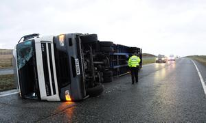 A lorry lies on its side after being blown over in high winds on the A66, County Durham, as fierce storms battered Britain today, with heavy rain and winds gusting up to 85mph
