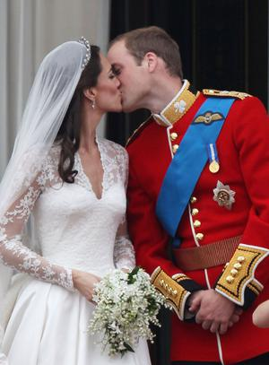 Their Royal Highnesses Prince William, Duke of Cambridge and Catherine, Duchess of Cambridge kiss on the balcony at Buckingham Palace on April 29, 2011 in London, England