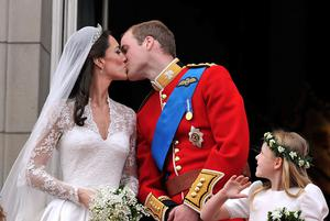 Prince William and his wife Kate Middleton, who has been given the title of The Duchess of Cambridge, kiss on the balcony of Buckingham Palace, London, following their wedding at Westminster Abbey.