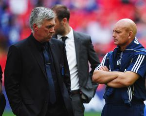 The departure of Ray Wilkins (right) and the break-up of his management partnership with Carlo Ancelotti (left) is thought to have been sanctioned by Roman Abramovich