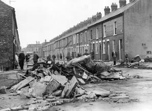 Riots : Belfast. August 1969.  Hooker Street, Belfast, and the remains of a massive fortress of flagstones ripped from the pavement.  (4/8/69)