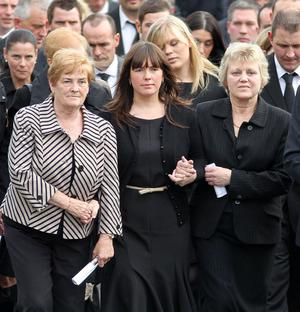 Family members at the head of the  funeral cortage of Noel Spence and his two sons Graham (30) and Nevin (22) at Ballynahinch Baptist Church