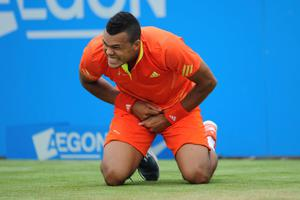 France's Jo-Wilfriend Tsonga reacts during his match against Croatia's Ivan Dodig during day four of the AEGON Championships at The Queen's Club, London