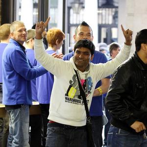 Customers enter the Apple Store in Covent Garden, London, as the new iPhone 5 goes on sale