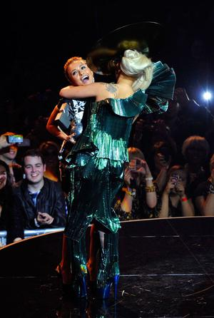 BELFAST, NORTHERN IRELAND - NOVEMBER 06:  Singer Lady Gaga receives the Best Song award for 'Born This Way' from actress Hayden Panettiere onstage during the MTV Europe Music Awards 2010 live show at at the Odyssey Arena on November 6, 2011 in Belfast, Northern Ireland.  (Photo by Gareth Cattermole/Getty Images)