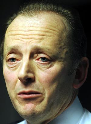 Chief Constable Sir Hugh Orde shows his emotions at a press conference after  the murder of Stephen Carroll