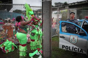 Samba school dancers take off their costumes after performing in a parade at the Sambadrome during carnival celebrations in Rio de Janeiro, Brazil, early Monday March 7, 2011. (AP Photo/Rodrigo Abd)