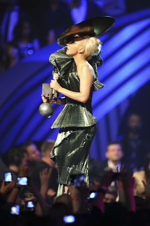 BELFAST, NORTHERN IRELAND - NOVEMBER 06:  Singer Lady Gaga receives the Best Song award for 'Born This Way' onstage during the MTV Europe Music Awards 2010 live show at at the Odyssey Arena on November 6, 2011 in Belfast, Northern Ireland.  (Photo by Ian Gavan/Getty Images)