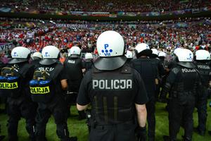 WARSAW, POLAND - JUNE 12:  Police in riot gear stand inisde the stadium during the UEFA EURO 2012 group A match between Poland and Russia at The National Stadium on June 12, 2012 in Warsaw, Poland.  (Photo by Shaun Botterill/Getty Images)