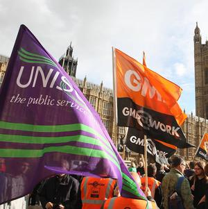 Trade union members take part in the 'Don't Break Britain' rally outside the Houses of Parliament