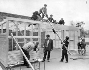 Building students of Dunlambert Secondary School are erecting a workshop garage for the school car and motor-cycle, 1967.