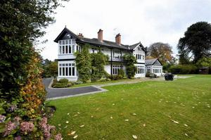 """<b>14. 'Skea Hall', 94 Moss Road, Carryduff, Belfast, County Antrim, BT8 8HX For Sale Offers Around £1,275,000</b> Approached by a sweeping driveway through electric gates and set on a mature elevated site, this magnificent detached family residence designed by Des Ewing and constructed two years ago, is sure to impress even the most discerning of purchasers. <p><b>To view property <a href=""""http://www.propertynews.com/Property/Belfast/ECSECS22242/94-Moss-Road/194686923/Page4"""" title=""""Click here to view property"""">Click here</a> </a></p></b>"""